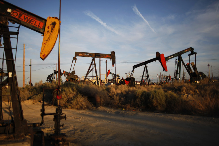 Pump jacks and wells are seen in an oil field on the Monterey Shale formation where gas and oil extraction using hydraulic fracturing, or fracking, is on the verge of a boom on March 23, 2014 near McKittrick, Calif. (Photo by David McNew/Getty)