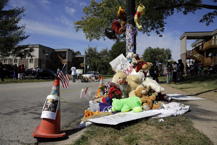 A memorial is cordoned off in Ferguson, Mo., near the spot of where Michael Brown was shot by Ferguson police office Darren Wilson. Sept. 23, 2014.