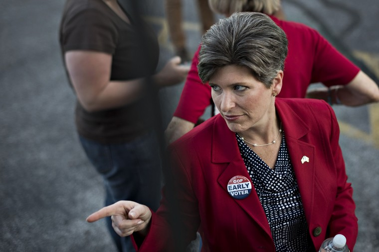 Republican Joni Ernst, running for the U.S. Senate in Iowa, gestures toward a supporter outside the Scott County GOP headquarters during a campaign stop in Davenport, Iowa, on Sept. 25, 2014.