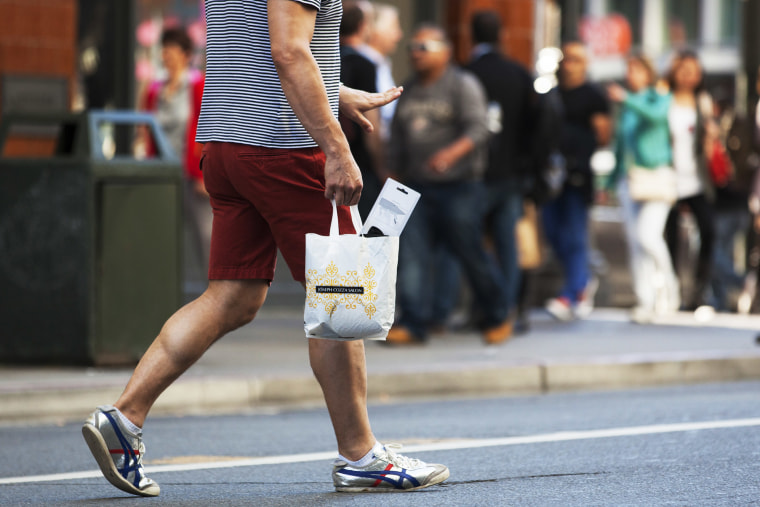 A man carries a plastic shopping bag on September 30, 2014  in San Francisco, California.