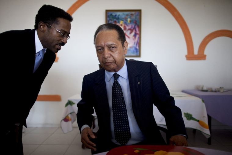 Jean-Claude Duvalier, right, Haiti's former dictator known as Baby Doc, listens to a translator during a meeting, in Port-au-Prince, Haiti, Jan. 24, 2011.