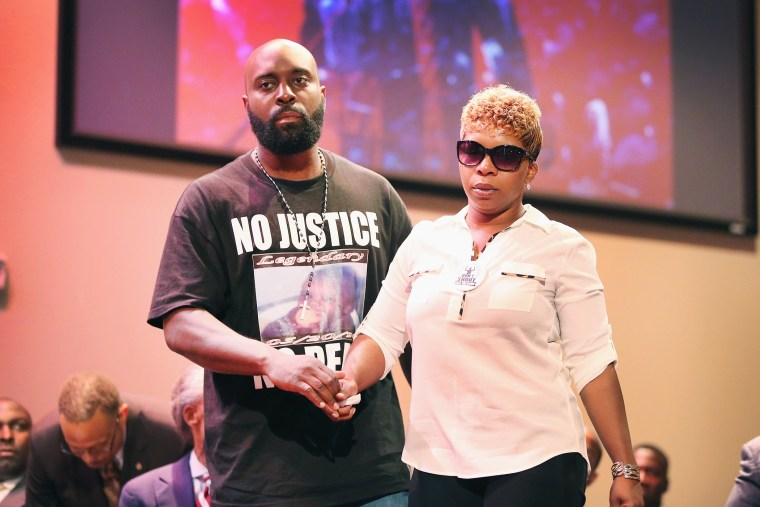 Michael Brown Sr. and Lesley McSpadden, the parents of slain teenager Michael Brown, attend a rally at Greater Grace Church on Aug. 17, 2014 in Ferguson, Mo. (Photo by Scott Olson/Getty)
