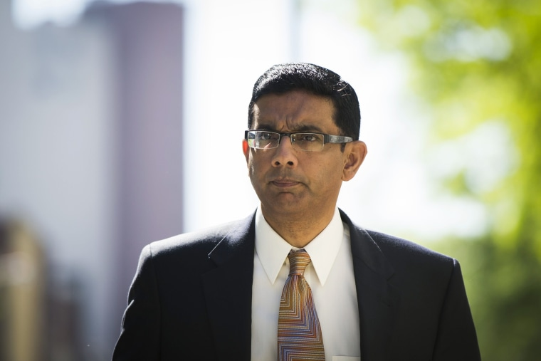 Dinesh D'Souza exits the Manhattan Federal Courthouse after pleading guilty in New York, May 20, 2014.