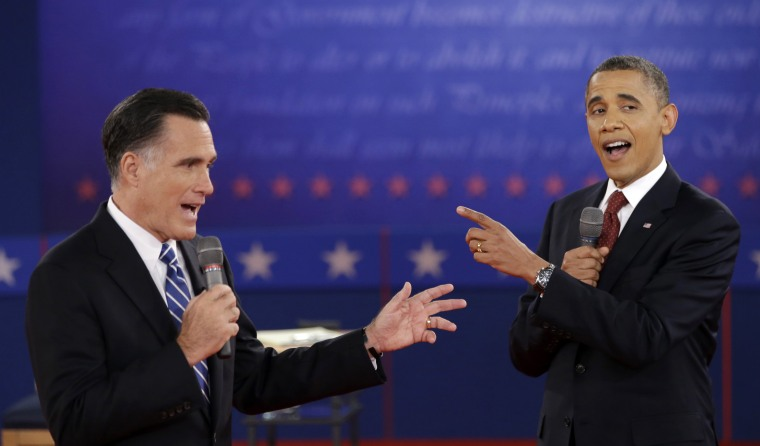 In this Oct. 16, 2012 file photo, President Barack Obama and Republican presidential candidate, former Massachusetts Gov. Mitt Romney exchange views during the second presidential debate at Hofstra University in Hempstead, N.Y.