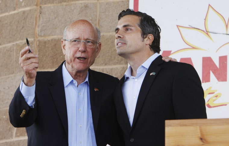 Sen. Pat Roberts, left, R-Dodge City, and Greg Orman, Independent for U.S. Senate, speak at the conclusion of their Senatorial Debate at the Kansas State Fair on Saturday, Sept. 6, 2014, in Hutchinson, Kan.