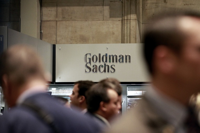 Traders work on the floor of the New York Stock Exchange near the Goldman Sachs stall on July 16, 2010.