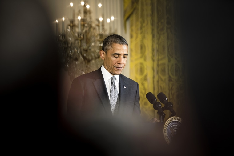 President Barack Obama pauses while speaking during an event in the East Room of the White House on May 5, 2014 in Washington, D.C.