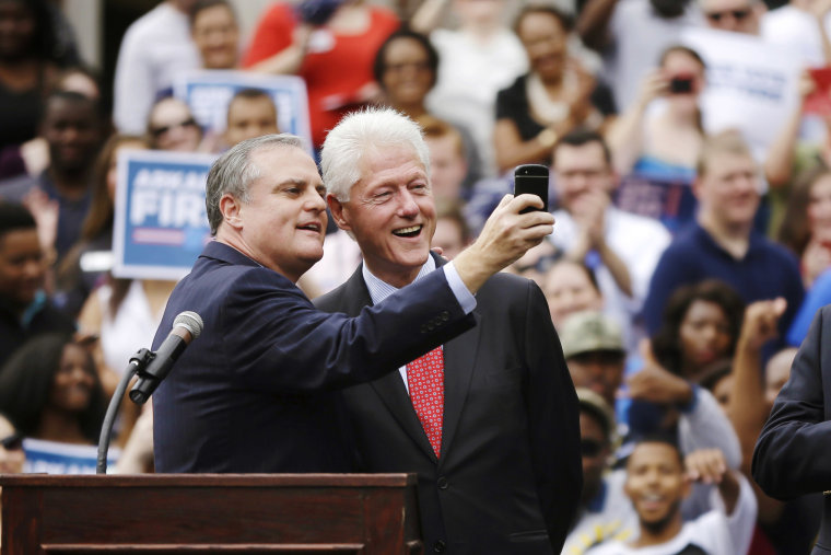 U.S. Sen. Mark Pryor, D-Ark., left, takes a selfie with former President Bill Clinton during a rally for Democrats at the University of Central Arkansas in Conway, Ark., Oct. 6, 2014.