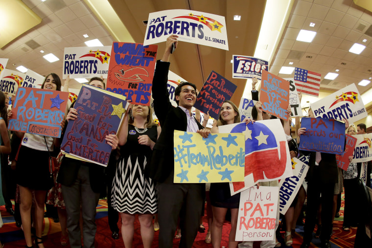 Supporters cheer for U.S. Sen. Pat Roberts at a Johnson County Republican's election watch party, Aug. 5, 2014, in Overland Park, Kan. (Photo by Charlie Riedel/AP)