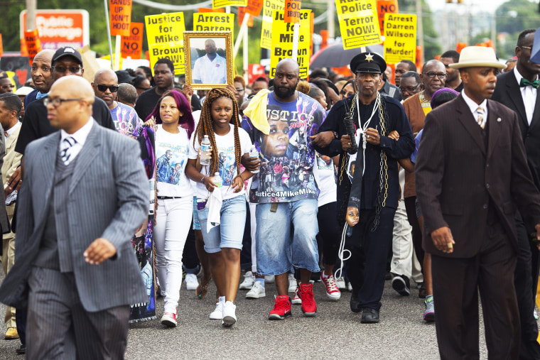 Michael Brown Sr. joins demonstrators at a rally for his son Michael Brown on August 30, 2014 in Ferguson, Missouri.