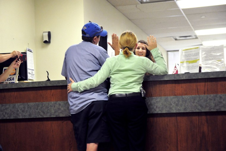 Jennifer Hasler (L) and Karina Tittjung take an oath to receive their marriage license at the Oklahoma County courthouse in Oklahoma City, Oklahoma on Oct. 6, 2014.
