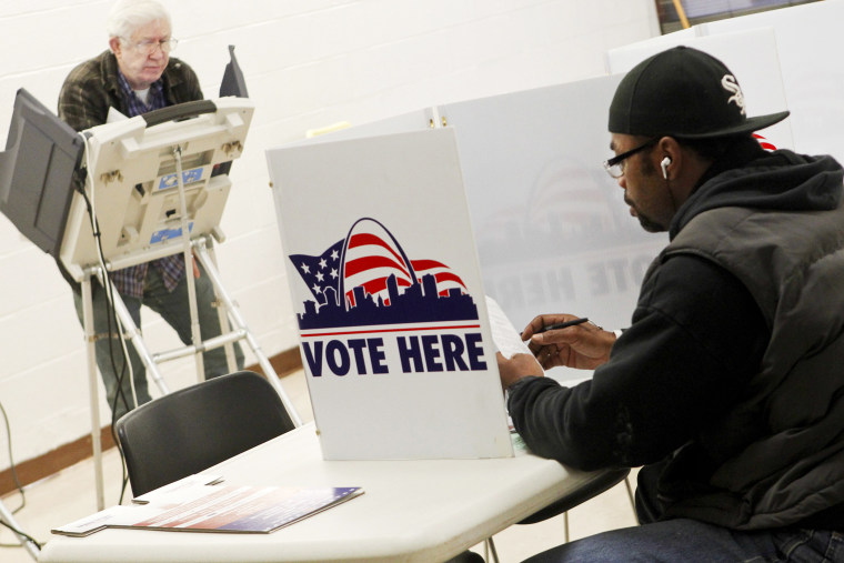 People vote at Missouri School for the Blind during the U.S. Presidential Election in St. Louis, Missouri, November 6, 2012.