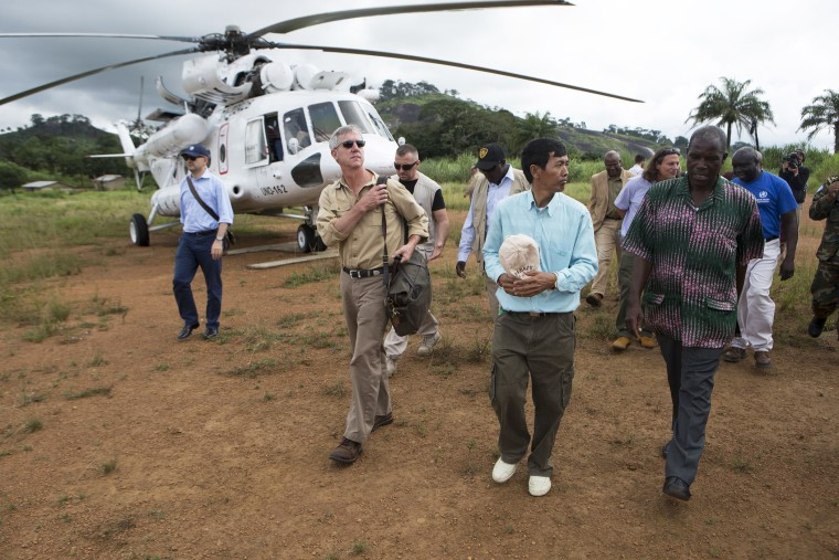Anthony Banbury (2nd L), Special Representative and Head of the United Nations Mission for Ebola Emergency Response to Liberia, arrives at Foya in Lofa County, October 2, 2014.