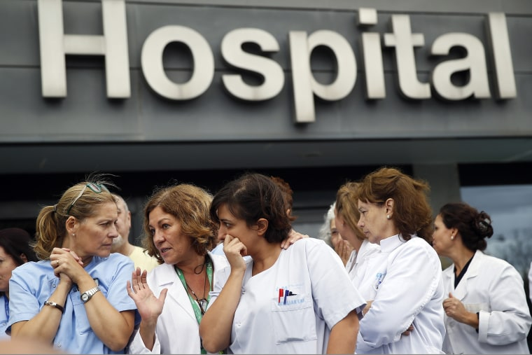 Health workers attend a protest outside La Paz Hospital calling for Spain's Health Minister Ana Mato to resign after a Spanish nurse contracted Ebola, in Madrid, October 7, 2014.