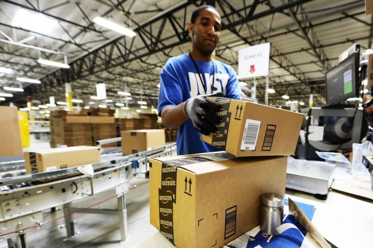 Employee Lamar Roby prepares shipping orders at Amazon's San Bernardino Fulfillment Center October 29, 2013 in San Bernardino, California.