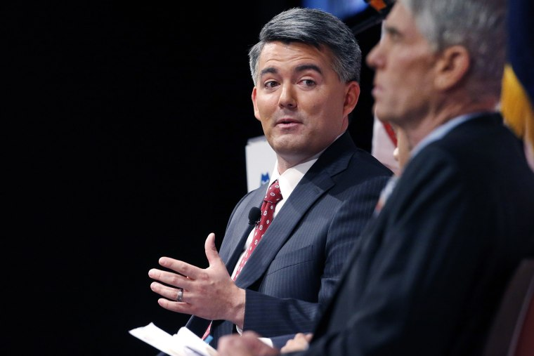 Senatorial candidate U.S. Rep. Cory Gardner, (R-Colo.), left, gestures during a debate with incumbent U.S. Sen. Mark Udall, (D-Colo.), in Denver on Oct. 6, 2014. (Brennan Linsley/AP)