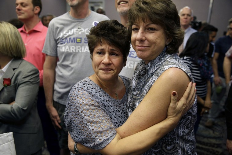 Mercy Leonard, left, embraces Gwen Leonard after an appeals court ruling that overturned Nevada's gay marriage ban on Oct. 7, 2014, in Las Vegas.