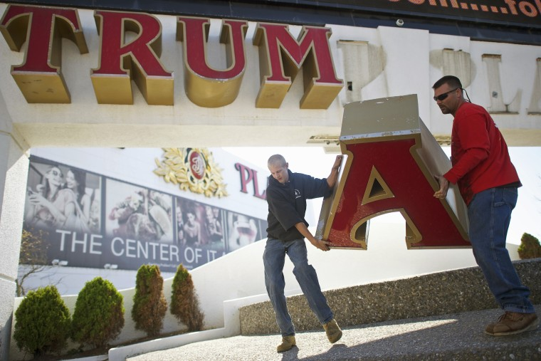 Nordaby and Demidio, of Calvi Electric, remove the letter 'A' from the signage of Trump Plaza Casino in Atlantic City, New Jersey