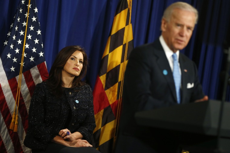 Actress Mariska Hargitay listens as Vice President Joe Biden speaks about reducing domestic violence, Wednesday, March 13, 2013, at the Montgomery County, Md.