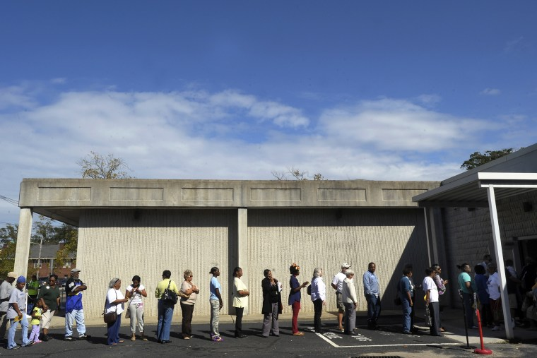 People wait in line to vote at the Board of Elections early voting site on October 18, 2012 in Wilson, North Carolina.