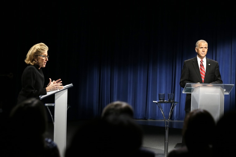 Sen. Kay Hagan, D-N.C., left, and North Carolina Republican Senate candidate Thom Tillis participate in a live televised debate at UNC-TV studios in Research Triangle Park , N.C., Oct. 7, 2014. (Photo by Gerry Broome/Pool/AP)