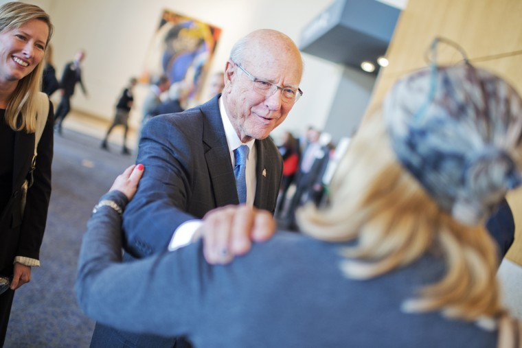 Sen. Pat Roberts, R-Kan., greets guests before a debate with Greg Orman, at the convention center in Overland Park, Kan., October 8, 2014.