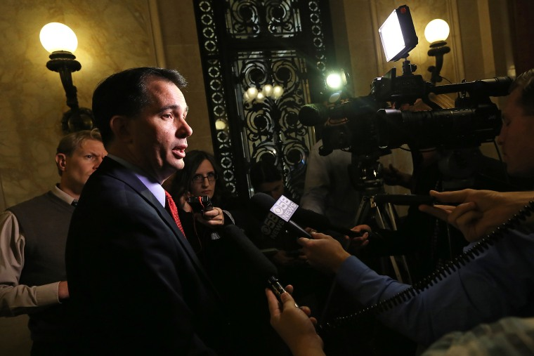Wisconsin Gov. Scott Walker speaks to members of the media at the Wisconsin State Capitol building in Madison, Wis. on Oct. 6, 2014. (Photo by John Hart/Wisconsin State Journal/AP)