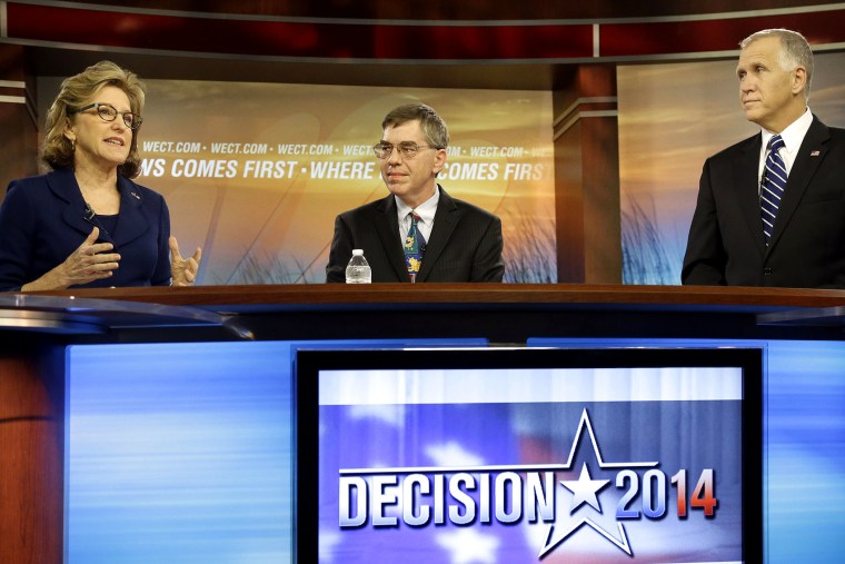 Sen. Kay Hagan, D-N.C., left, speaks as Libertarian Party Senate candidate Sean Haugh, center, and North Carolina Republican Senate candidate Thom Tillis listen during a live televised debate at WECT studios in Wilmington, N.C. on Thursday, Oct. 9, 2014.
