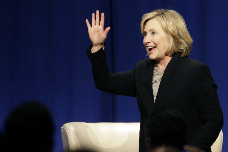 Former U.S. Secretary of State Hillary Rodham Clinton waves as she leaves the Economic Club of Chicago in Chicago on Oct. 8, 2014. (Nam Y. Huh/AP)