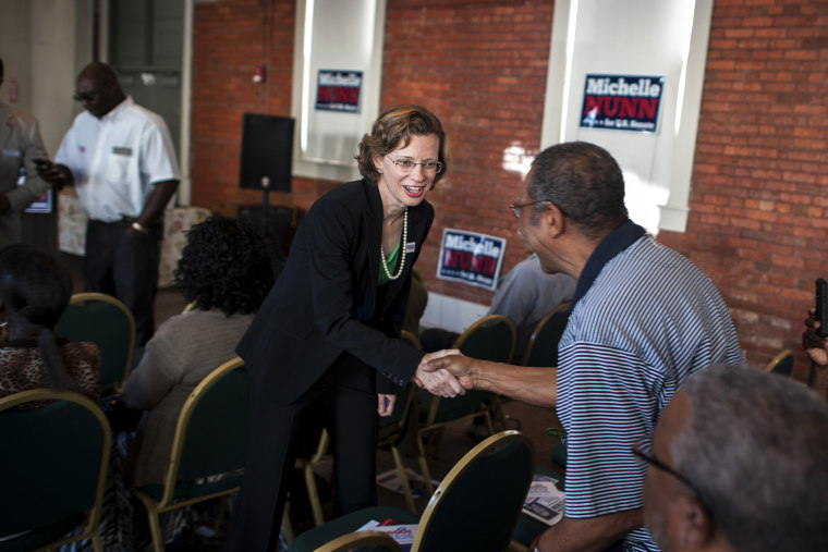 Michelle Nunn, the Democratic candidate for Senate in Georgia, greets supporters at a campaign event in Waycross, Ga., Aug. 13, 2014. (Photo by Stephen Morton/The New York Times/Redux)