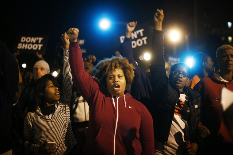 Protesters cheer after blocking an intersection after a vigil in St. Louis, Mo. on Oct. 9, 2014. (Photo by Jim Young/Reuters)