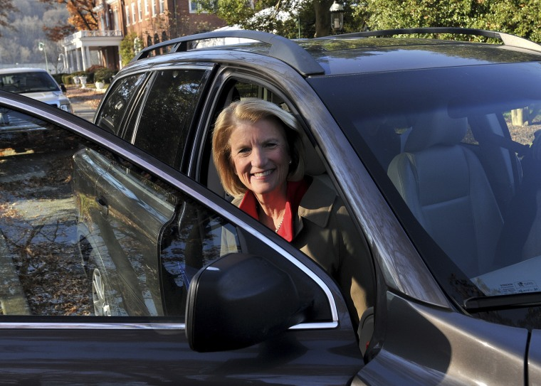 Congresswoman Shelley Moore Capito gets out of her car on her way to the Capitol, where she officially announced that she will run in 2014 for the U.S. Senate, in Charleston, W.Va. Monday, Nov. 26, 2012.