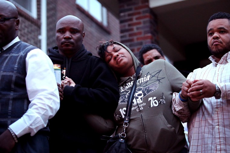 Family members attend a candlelight vigil for 18-year-old Vonderrit Myers Jr. on Oct. 9, 2014 in St Louis, Mo. Meyers was shot and killed by an off duty St. Louis police officer.