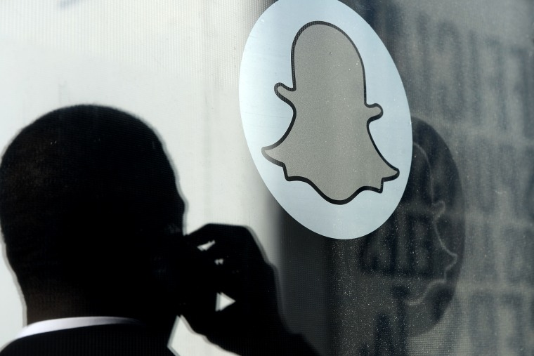The logo of Snapchat is seen at the front entrance new headquarters of Snapchat, on Nov. 14, 2013 in Venice, Calif.