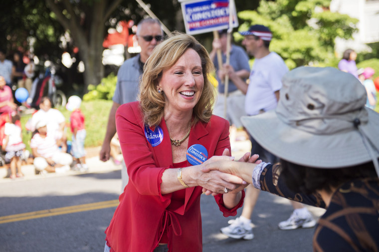 Barbara Comstock, Republican candidate for Virginia's 10th Congressional District, greets attendees of Leesburg's Independence Day parade, July 4, 2014, in Leesburg, Va. (Photo By Tom Williams/CQ Roll Call/Getty)