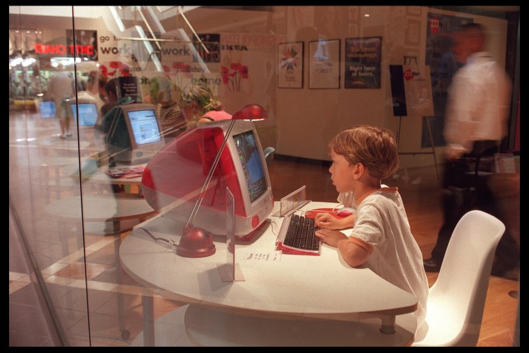 A young boy uses a computer at the Media Shopping center in Burbank, Calif. on Aug. 28, 1999. (Photo by Dan Callister/Hulton/Getty)