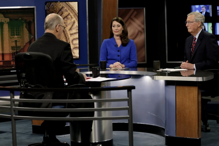 Republican U.S. Senate Minority Leader Mitch McConnell (R) and Democratic U.S. Senate candidate Alison Lundergan Grimes (L) prepare for their debate at the Kentucky Education Television network headquarters in Lexington, Ky on Oct. 13, 2014.