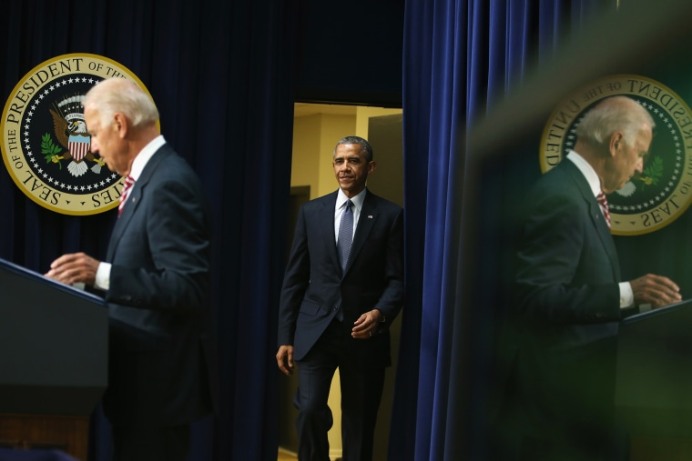U.S. President Barack Obama is introduced by U.S. Vice President Joseph Biden before signing the Workforce Innovation and Opportunity Act on July 22, 2014 in Washington, DC.