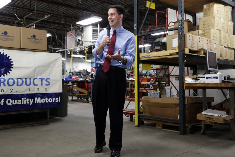 Republican Wisconsin Gov. Scott Walker campaigns for re-election at a manufacturing company in Racine, Wis. on Sept. 23, 2014.