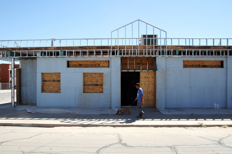 A man walks past the former site of a clinic that offered abortions in El Paso, Texas on Oct. 3, 2014.