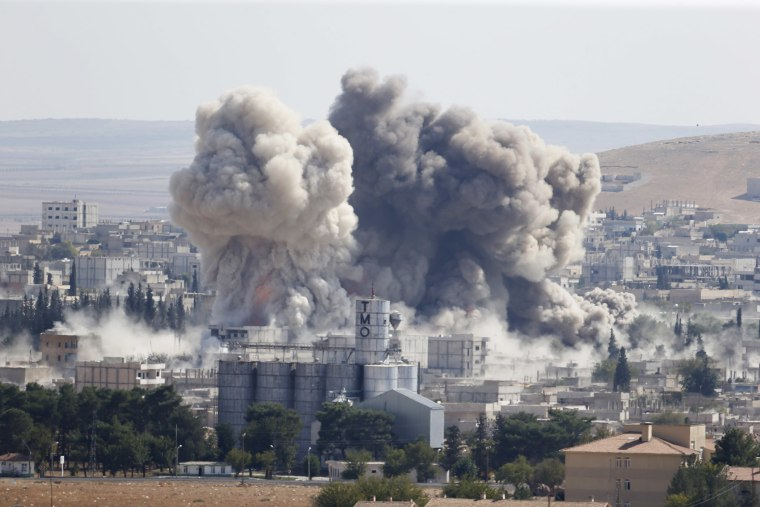 Smoke rises after an U.S.-led air strike in the Syrian town of Kobani on Oct. 8, 2014.