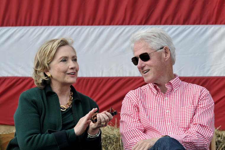 Former President Bill Clinton and his wife former Secretary of State Hillary Rodham Clinton attend the 37th Harkin Steak Fry, Sept. 14, 2014 in Indianola, Iowa.