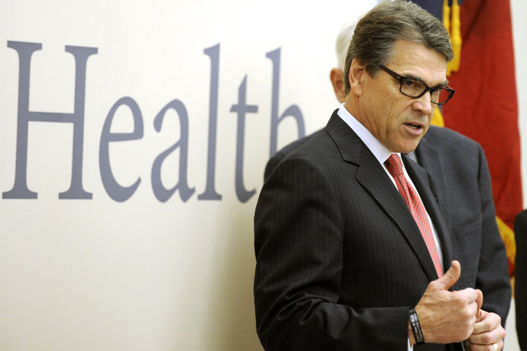 Texas Gov. Rick Perry makes a point as he speaks during a visit to the Galveston National Lab on Oct. 7, 2014, in Galveston, Texas.