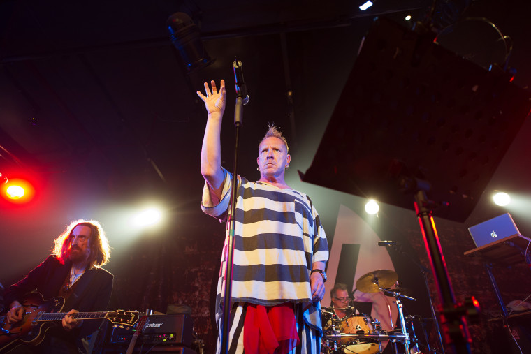 British singer John Lydon, known as Johnny Rotten, performs with his band Public image Limited (PiL) in Beijing on March 30, 2013.