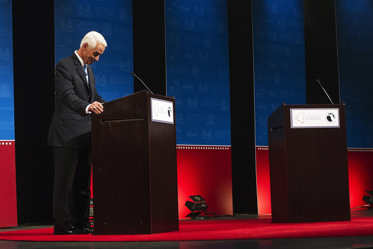 Former Florida Governor and challenger, Charlie Crist, appears alone for the first few minutes of a their gubernatorial debate, as Florida Governor Rick Scott delays taking the stage on Oct. 15, 2014.