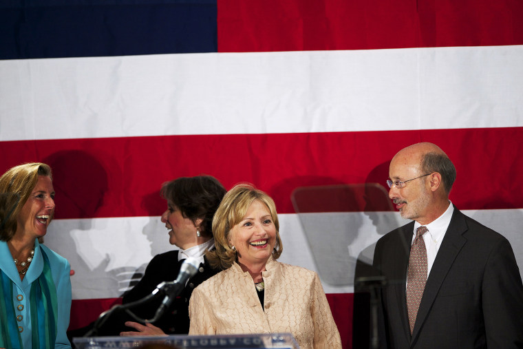 Hillary Clinton join Democratic challenger for Pennsylvania Governor Tom Wolf on stage at the National Constitution Center in Philadelphia, Penn. on Oct. 9, 2014.