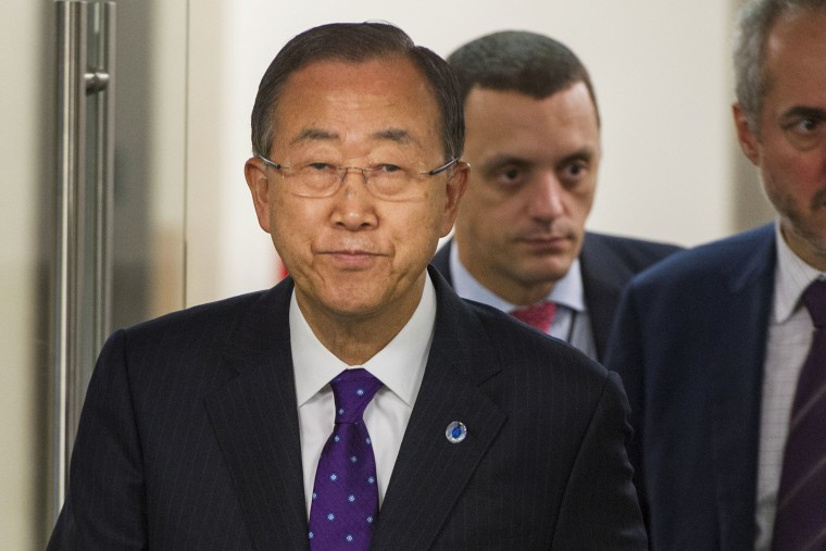 """In this photo provided by the United Nations, United Nations Secretary-General Ban Ki-moon arrives for a press briefing wearing a purple tie in recognition of \""""Spirit Day\"""" on Oct. 16, 2014 at the U.N. headquarters."""