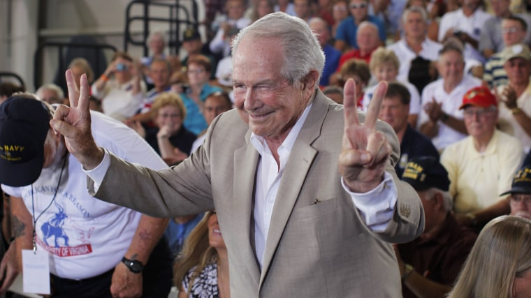 Evangelist Pat Robertson acknowledges the audience before he takes a seat before Republican presidential candidate Mitt Romney campaigns in Virginia Beach, Va., on Sept. 8, 2012.