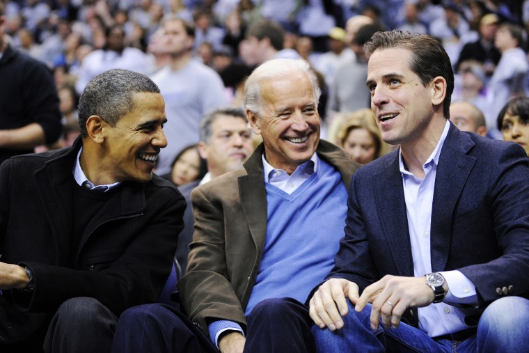 Hunter Biden, right, son of Vice President Joe Biden, center, talking with President Barack Obama during a college basketball game in Washington, D.C. on Jan. 30, 2010.