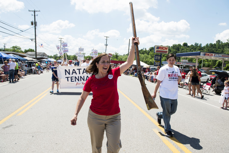 U.S. Senate candidate West Virginia Secretary of State Natalie Tennant marches with her musket in the Ripley 4th of July Parade in Ripley, W. Va., on July 4, 2014.